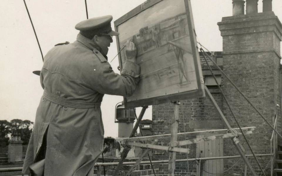 Barnett Freedman painting on a rooftop in France (1940)