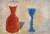 Painting of a red jar and blue goblet simply rendered as blocks of colour against agrey and yellow background