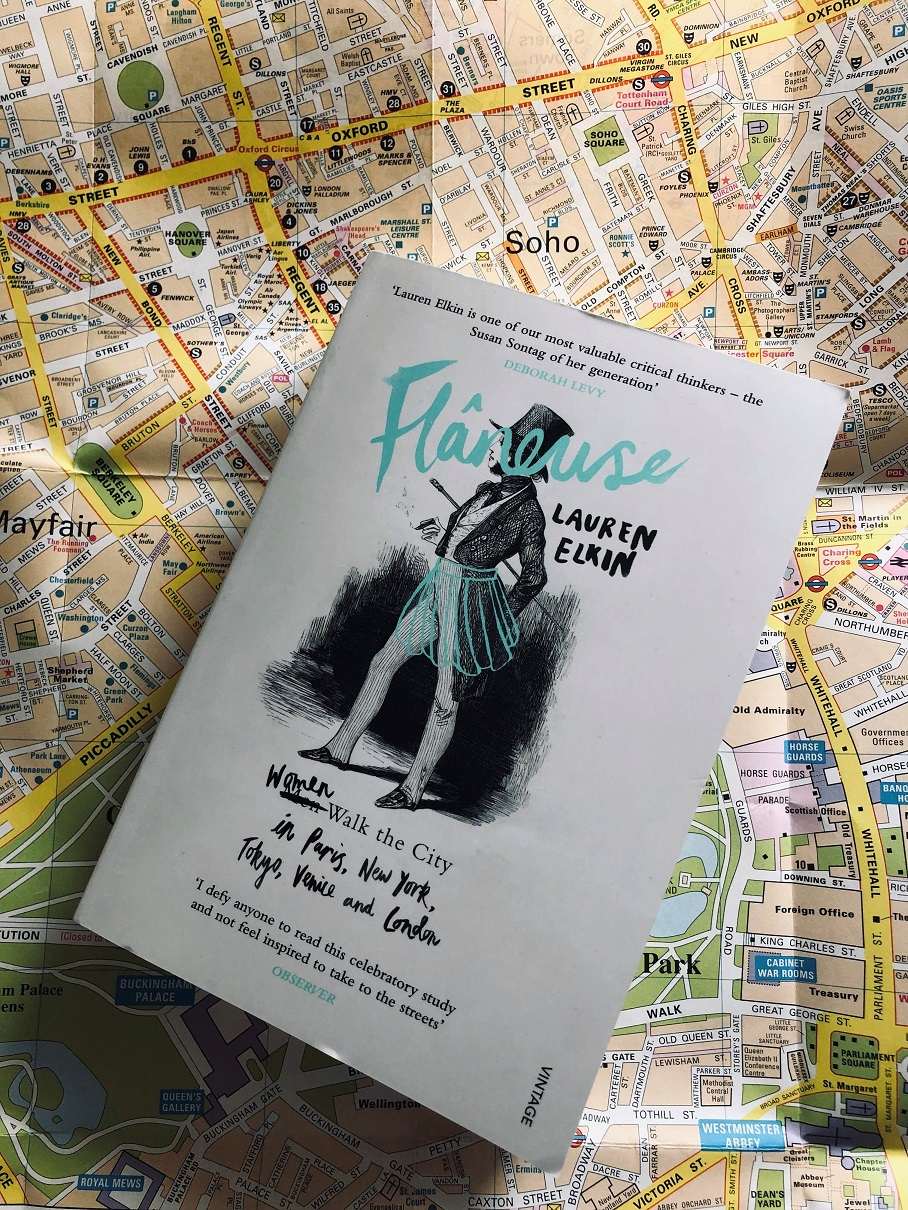 Photograph of the book Flaneuse by Lauren Elkin against a map of London.