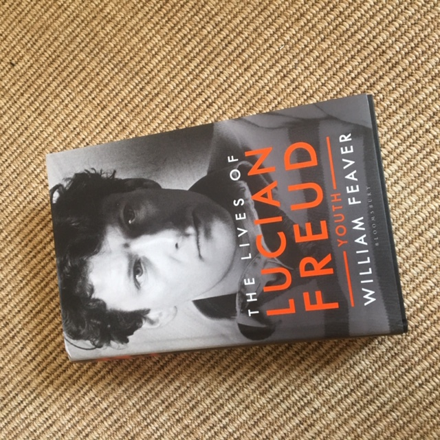 A photograph of The Lives of Lucian Freud by William Feaver against a carpet background.