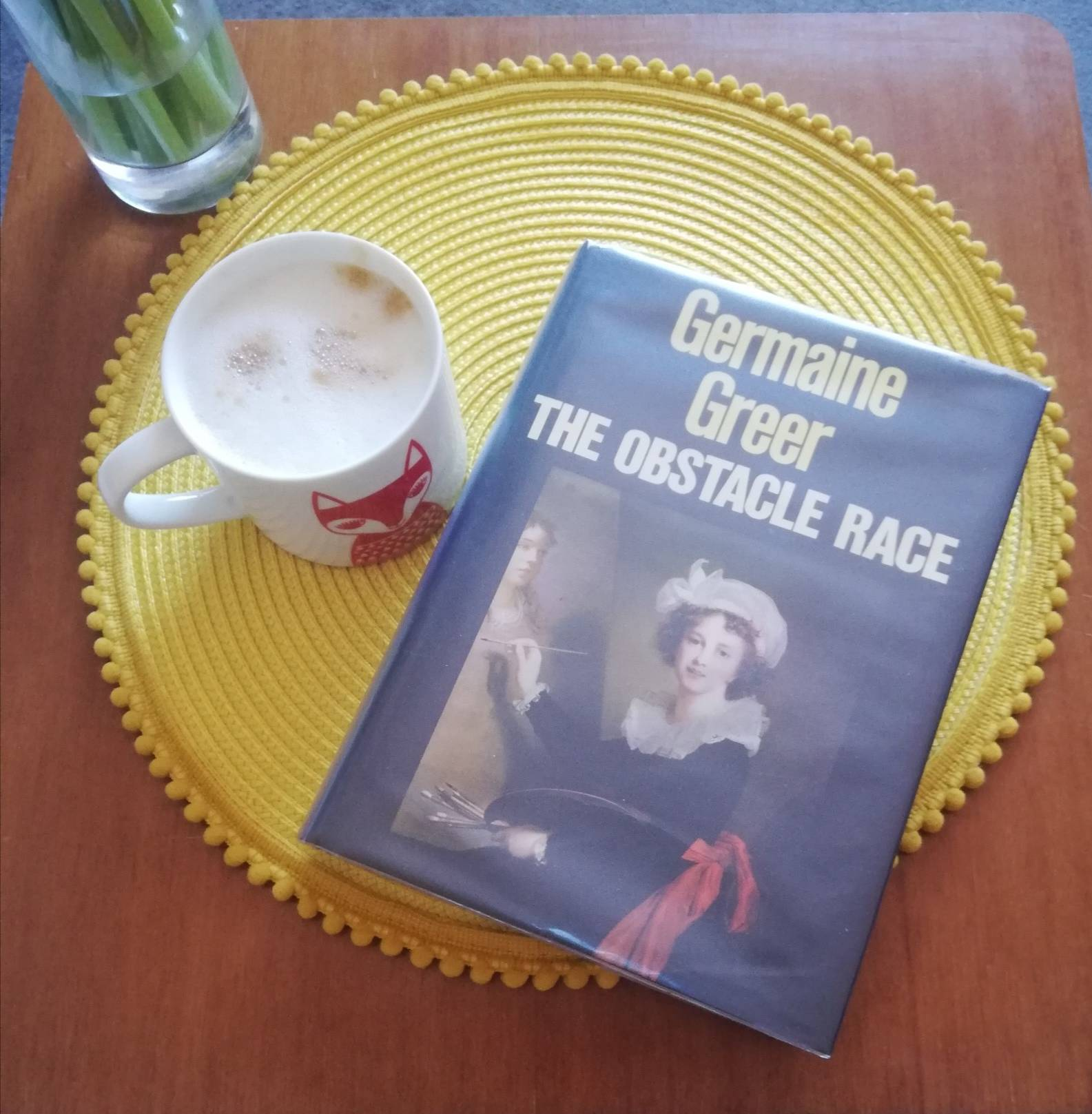 Photograph of the book by Germaine Greer - The Obstacle Race, with a cup of coffee.