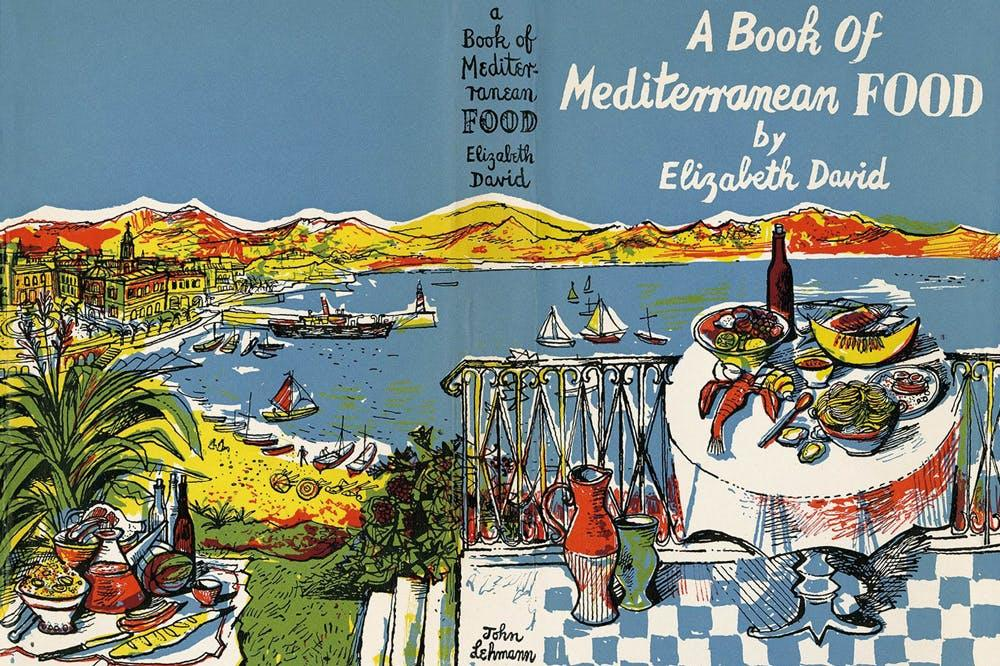 A book cover showing a table laden with food sat above a sweeping Mediterranean bay