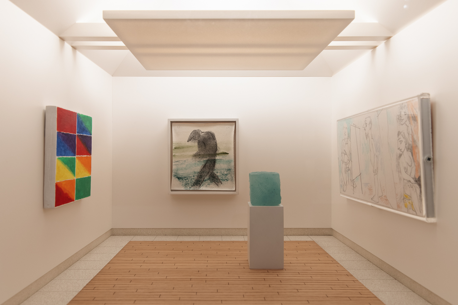 A model art gallery room with white walls, a dropped ceiling and wooden and stone look flooring. On the left hand wall is a painting of eight panels divided into triangles and painted in red, orange, yellow, green and blue. On the central wall is a painting of a silhouette of a man in a flat cap. On the right hand wall is a painting of people peering over their shoulders at each others canvases. In the centre right is a plinth with a mint green glass cube.