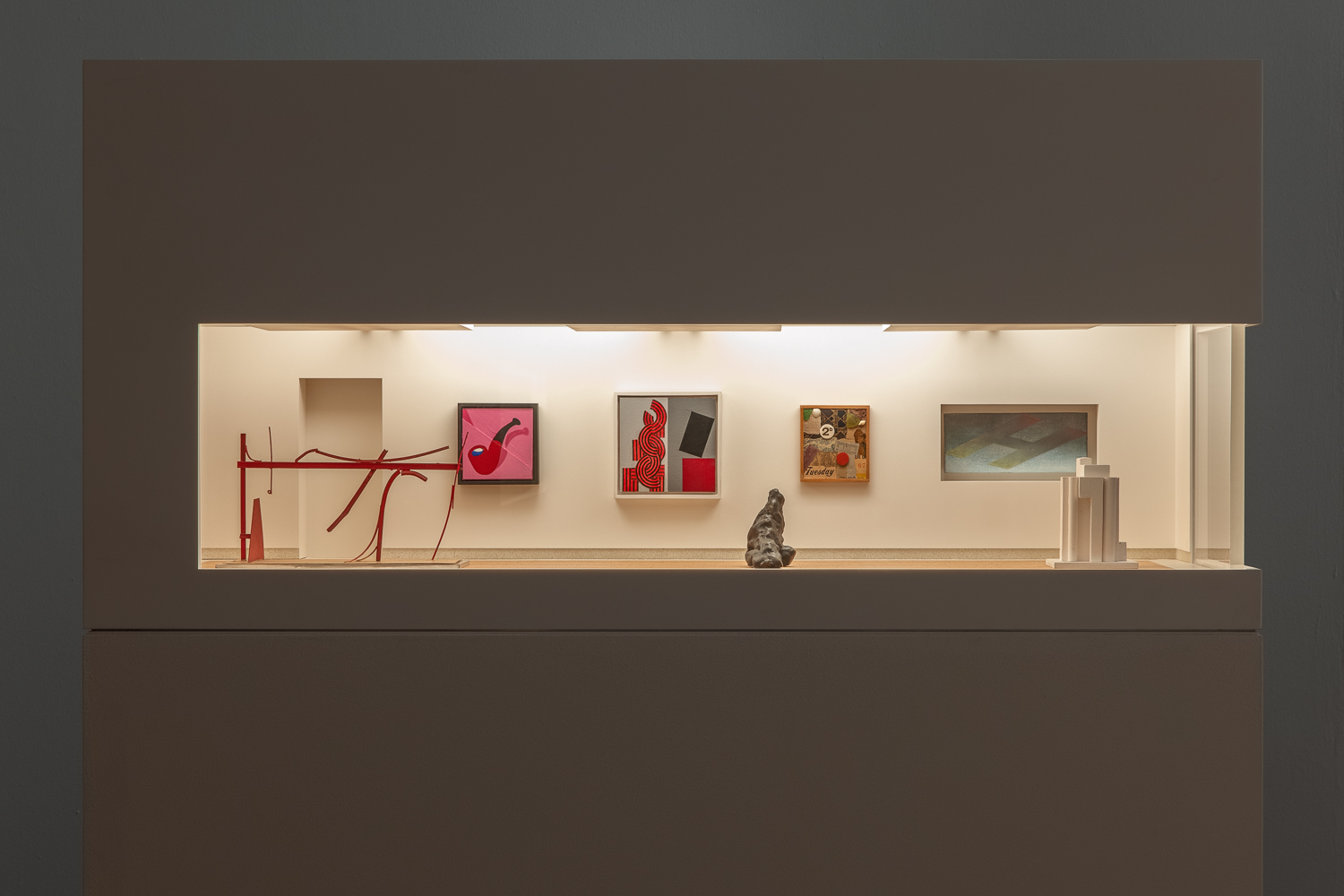 A model art gallery consisting of one room with white walls and wooden and stone-look flooring and filled with paintings and sculptures.